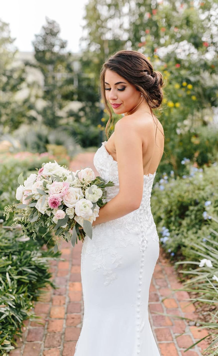 M3 Beauty, bride on brick path looking over shoulder to camera
