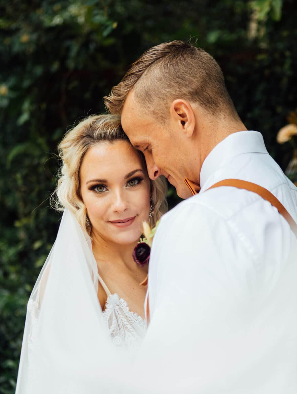 bride and groom outside, bride facing camera