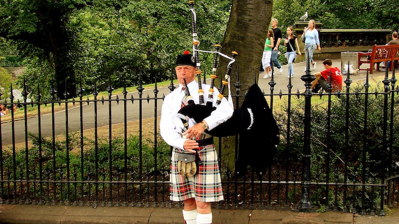 Music Remembrance bagpipe player performing in a kilt