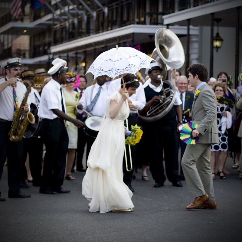 Music Remembrance band performing on street standing around bride and groom