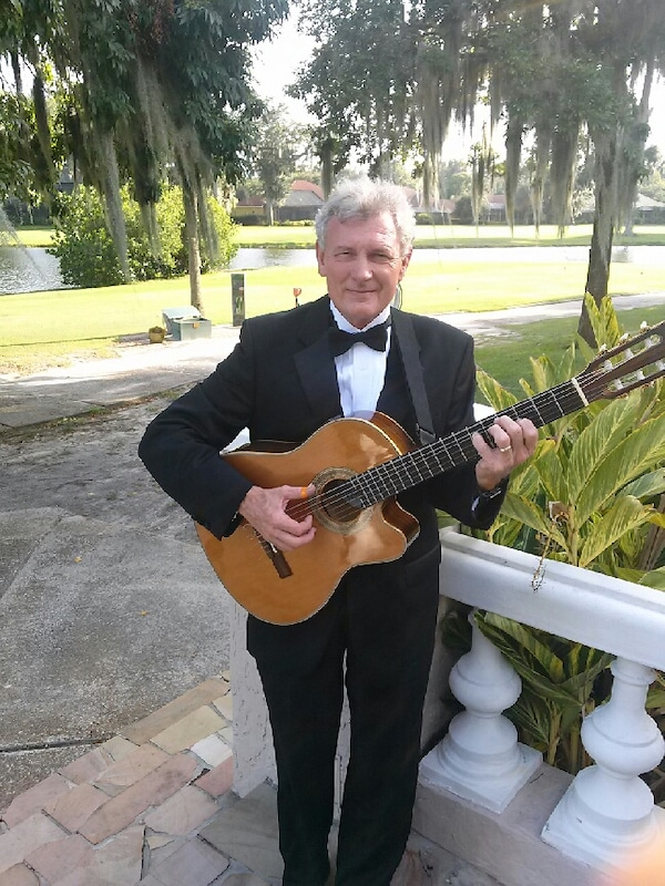 Music Remembrance guitarist outside performing in tux
