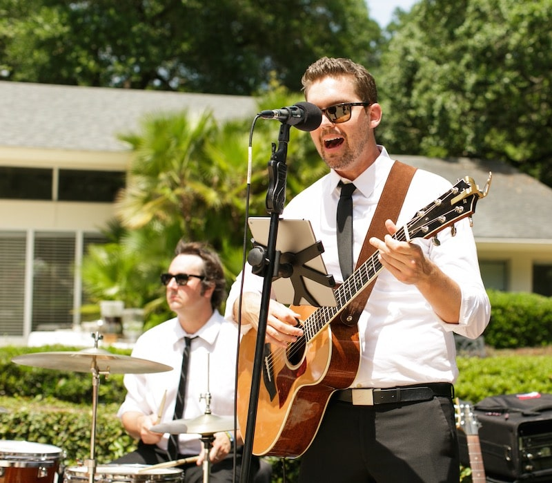 Music Remembrance band playing and singing outside at wedding