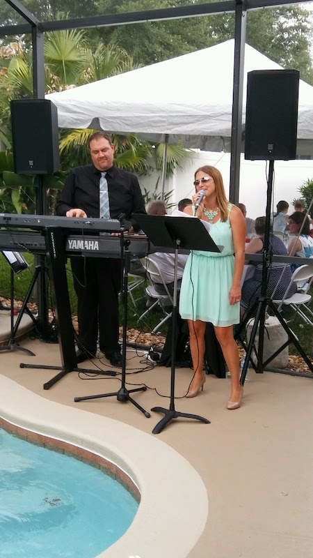 Music Remembrance band performing and singing outside near pool