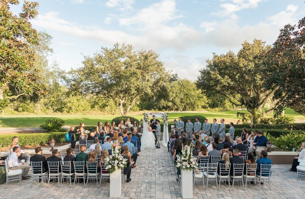 wedding ceremony outside overlooking golf course