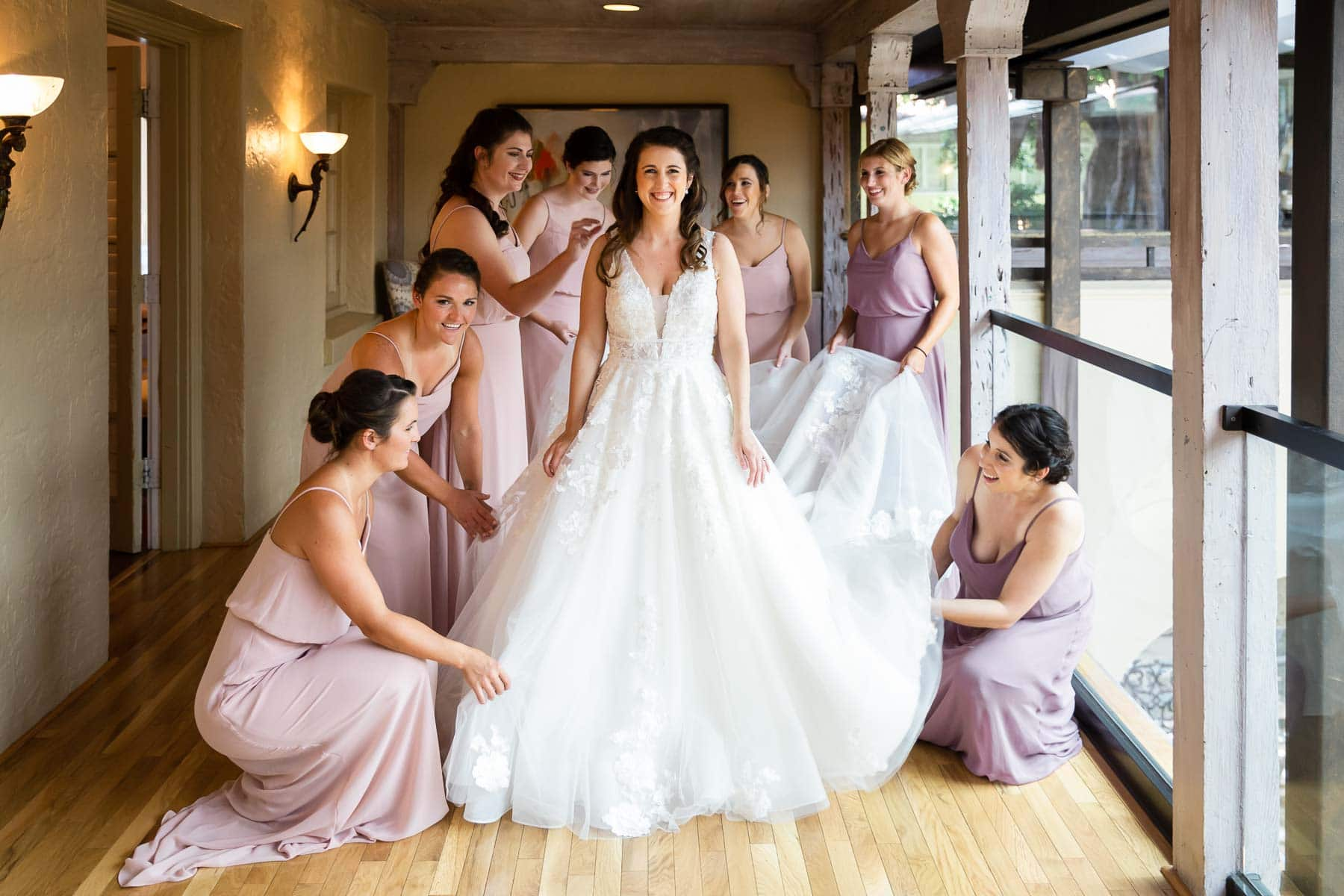 bride getting ready with bridesmaids around her