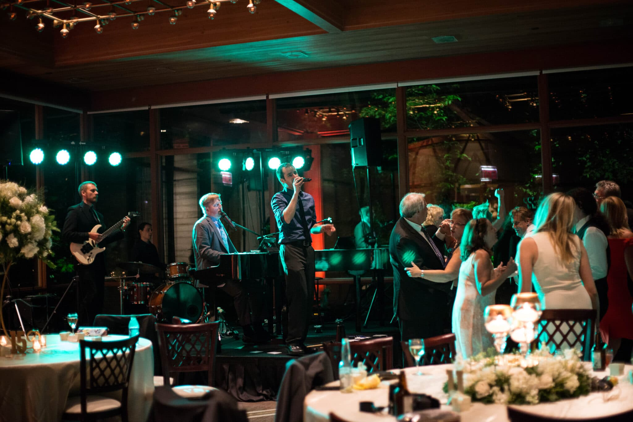 Felix and Fingers Dueling Pianos while guests dancing at wedding