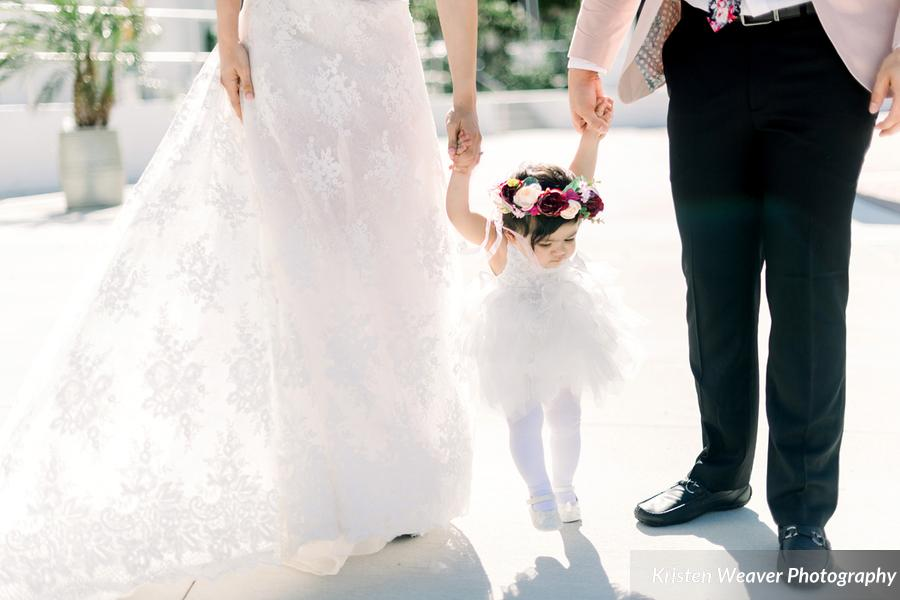 bride & groom with flower girl