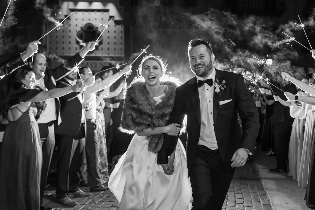 bride & groom walking under sparklers