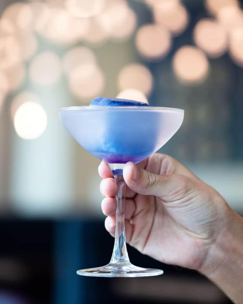 frozen purple drink in margarita glass at celeste hotel bar