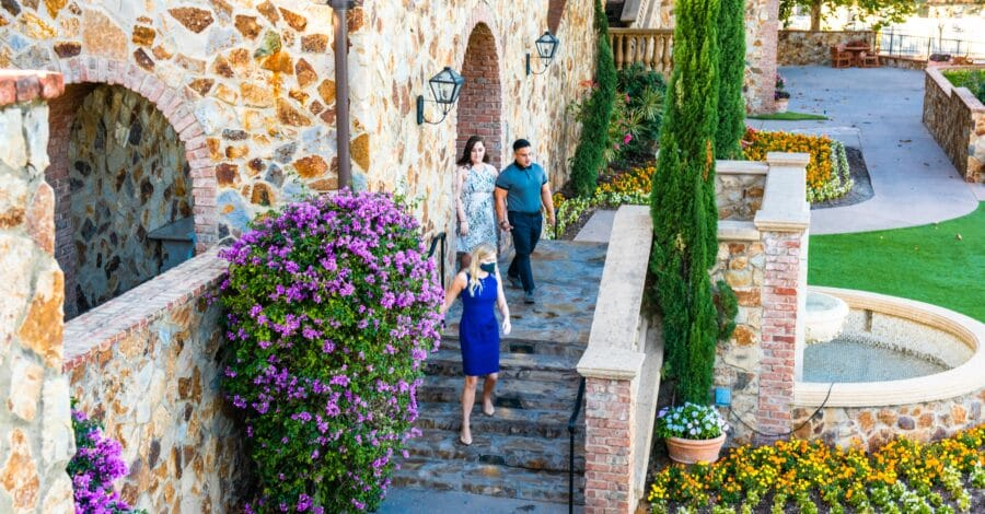 engaged couple walk through wedding venue looking for how to choose a wedding venue