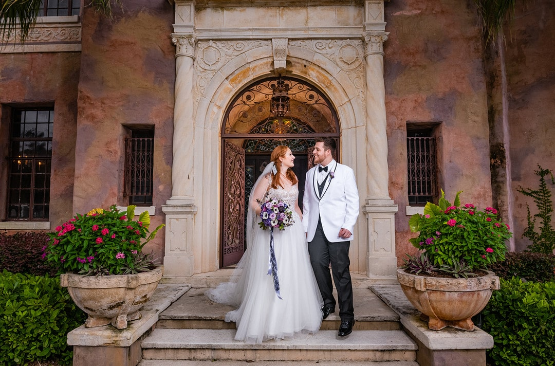 bride and groom right outside the front doors of their wedding venue the howey mansion