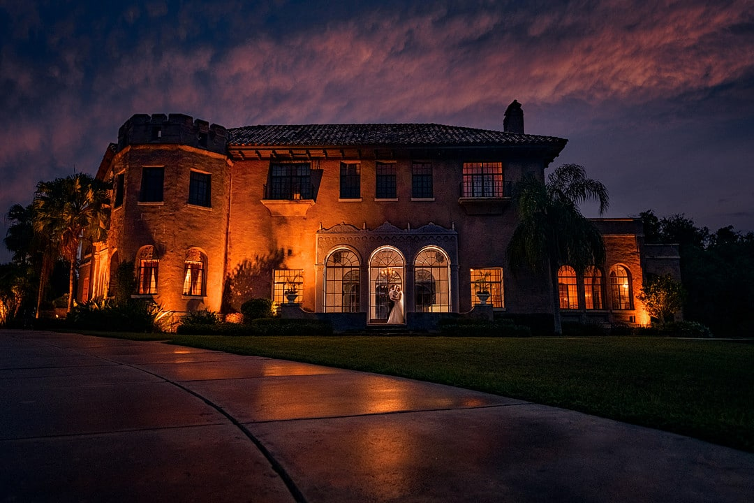 dark and moody wedding venue night image with amber lighting on venue