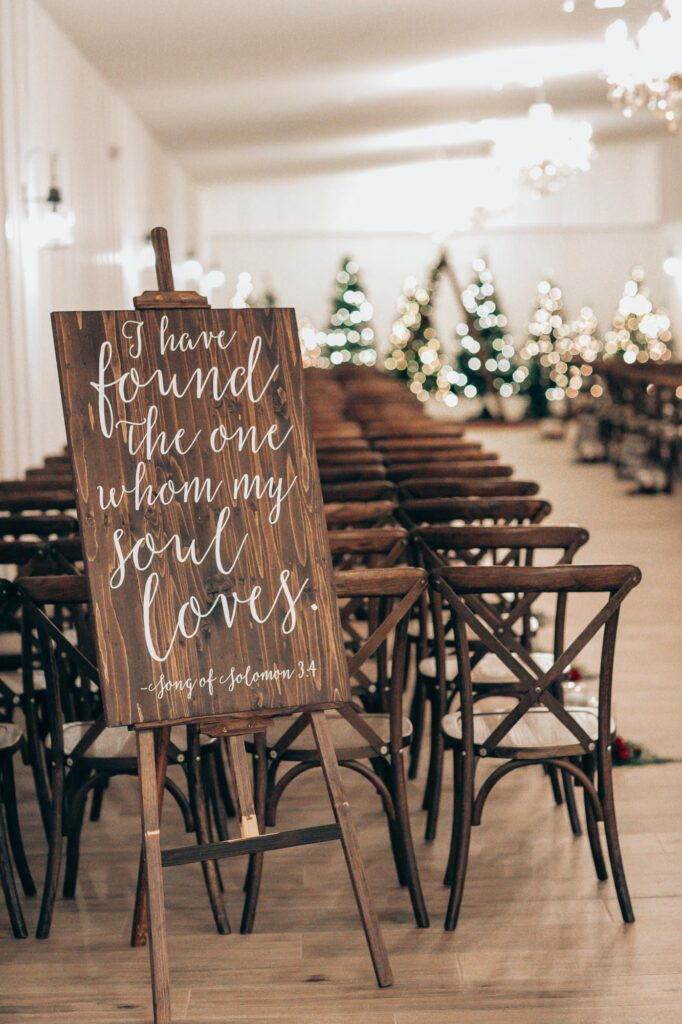 bible verse setup as decoration during inside wedding ceremony at The Grand Ol' Barn