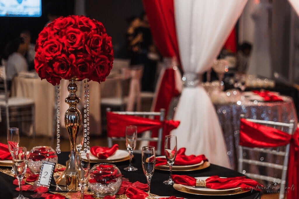 red black and gold wedding reception decor
