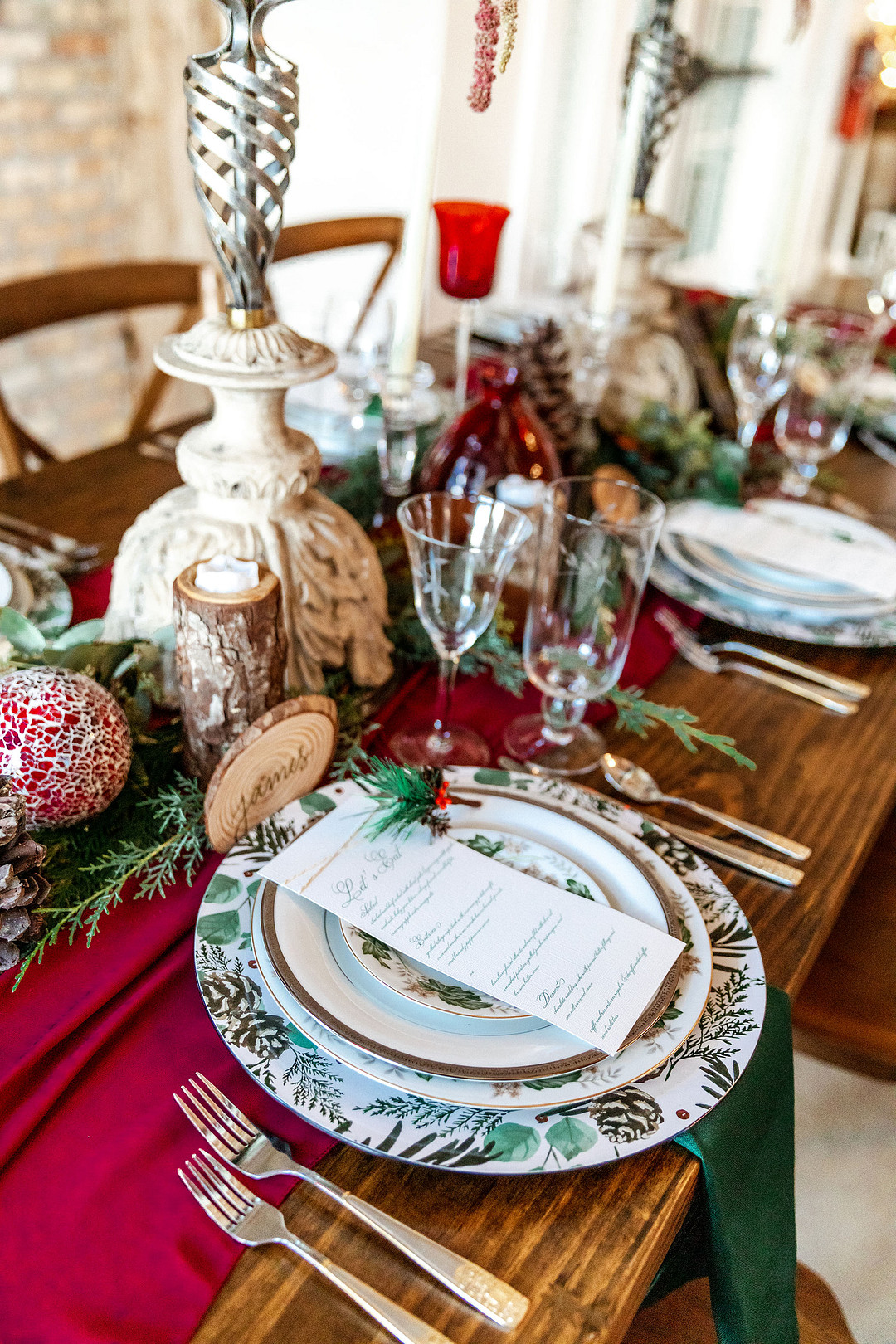 table decor at romantic christmas wedding with unique plates and menu sitting on top
