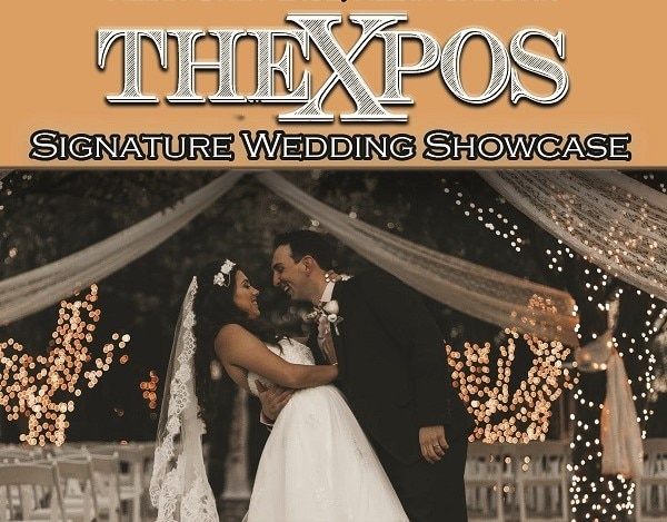 bride and groom standing under lit trees for The Xpos Signature Wedding Showcase
