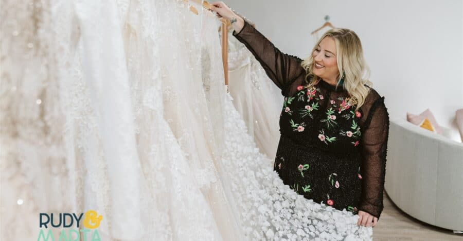 rack of several different styles of wedding dresses available at The Bridal Finery