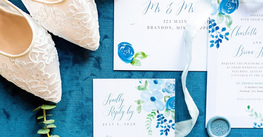 dusty pastel wedding inspiration flat lay design with lace heels and ribbon and calligraphy pieces