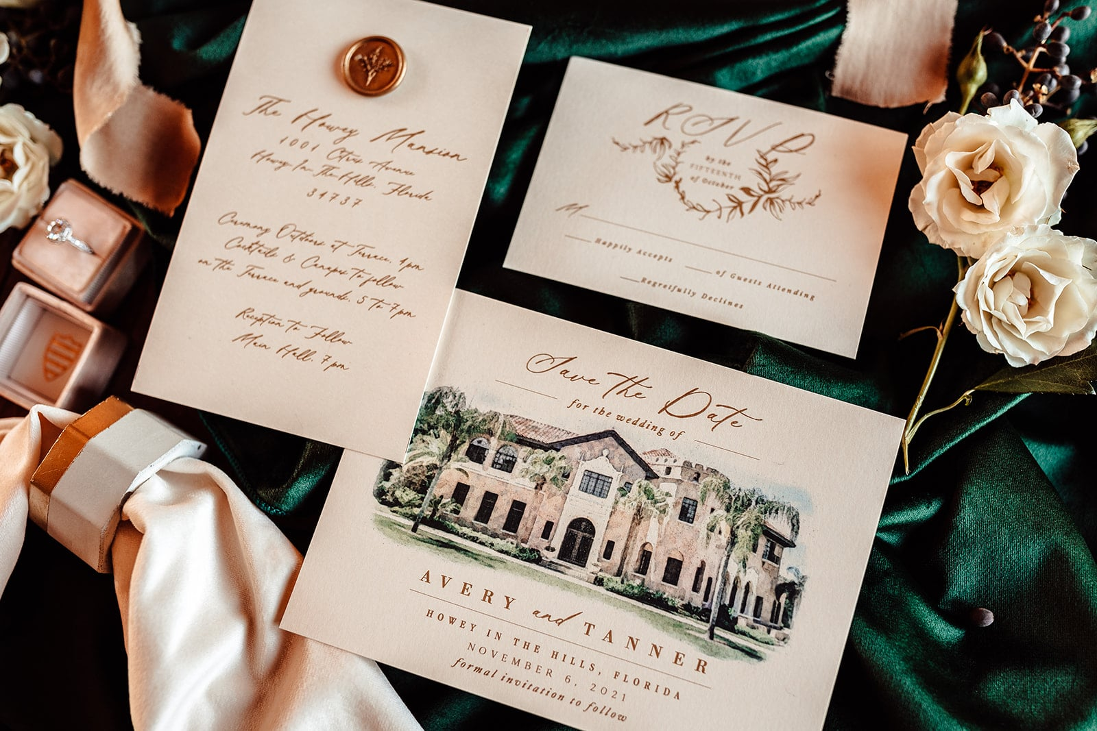 parts of wedding invitation suite with custom drawing of the historic wedding venue with white flowers on the right and ring inside ring box to the left of the image
