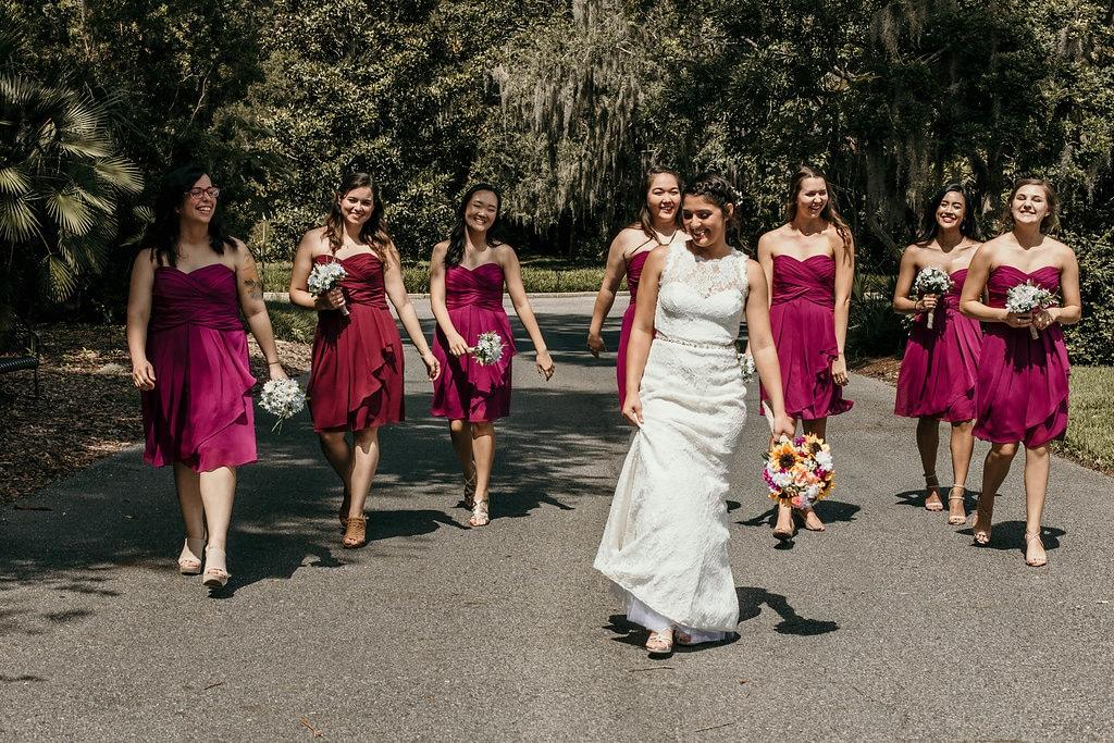 bride and bridesmaids walking up a path