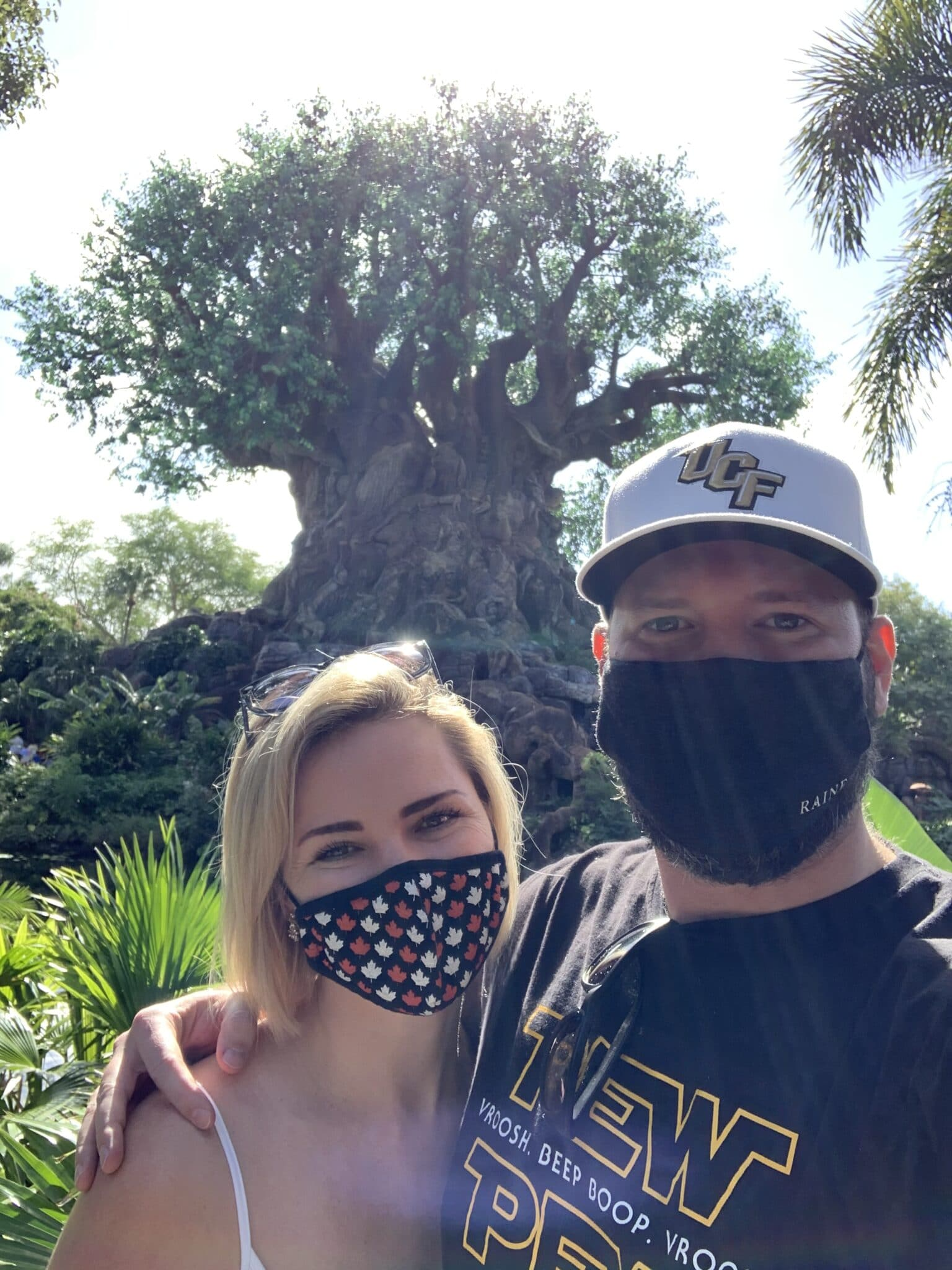 newly engaged couple in front of Animal Kingdom Tree of Life