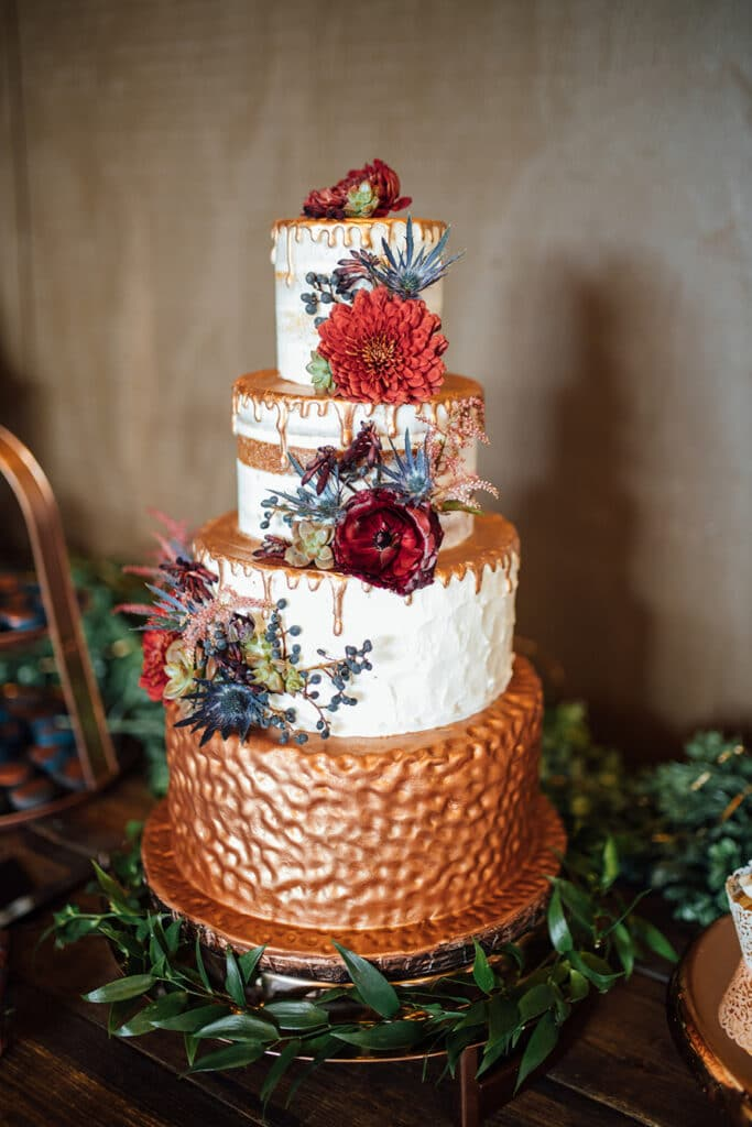 Gold and dark floral 4 tier cake