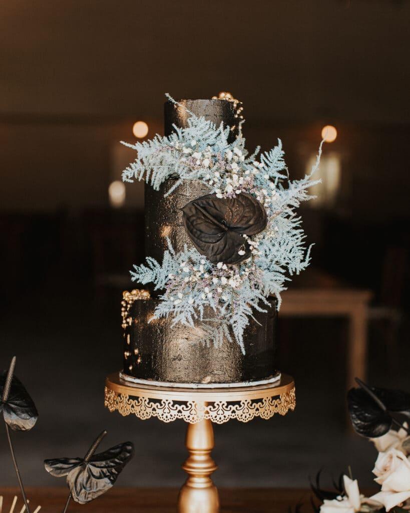 black 3 tier cake with sparkle