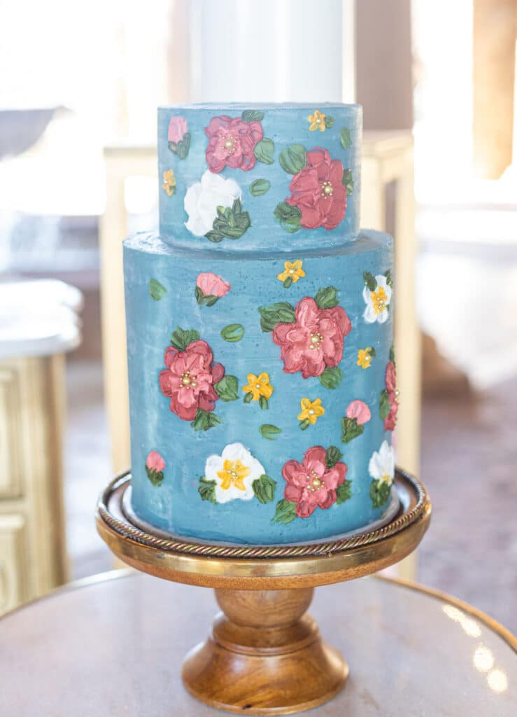 blue cake with painted flowers