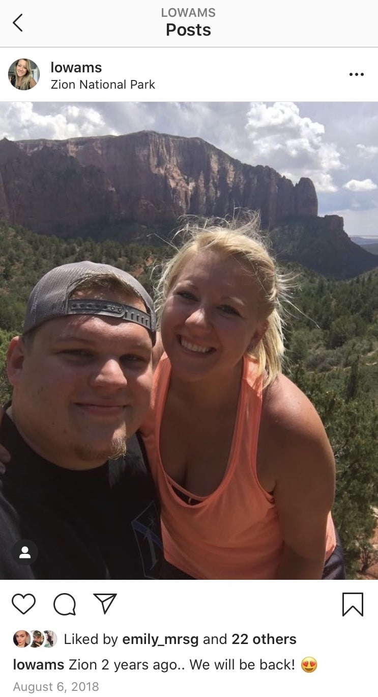 instagram screenshot of post made at national park of couple man wearing hat backwards and blonde woman wearing orange tank top