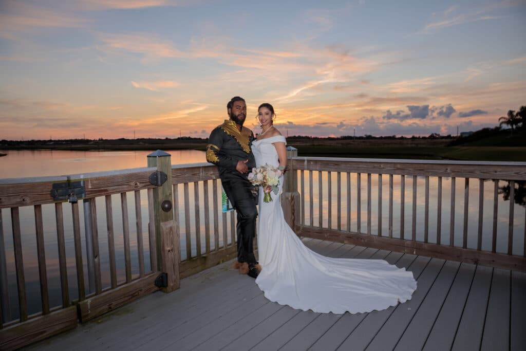 bride and groom at sunset on boardwalk - margaritaville resort orlando