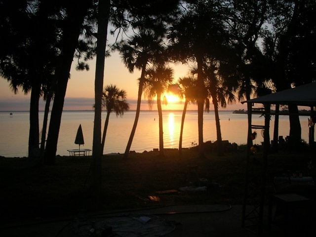 sunset on river with oak trees at titusville florida wedding venue