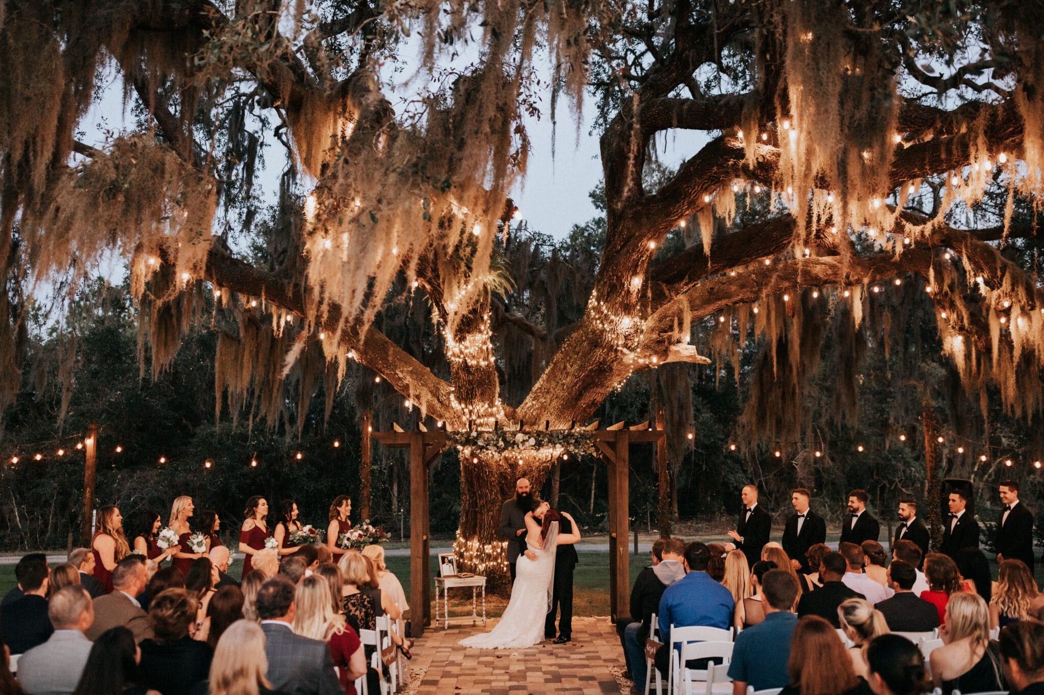ceremony under trees with lights