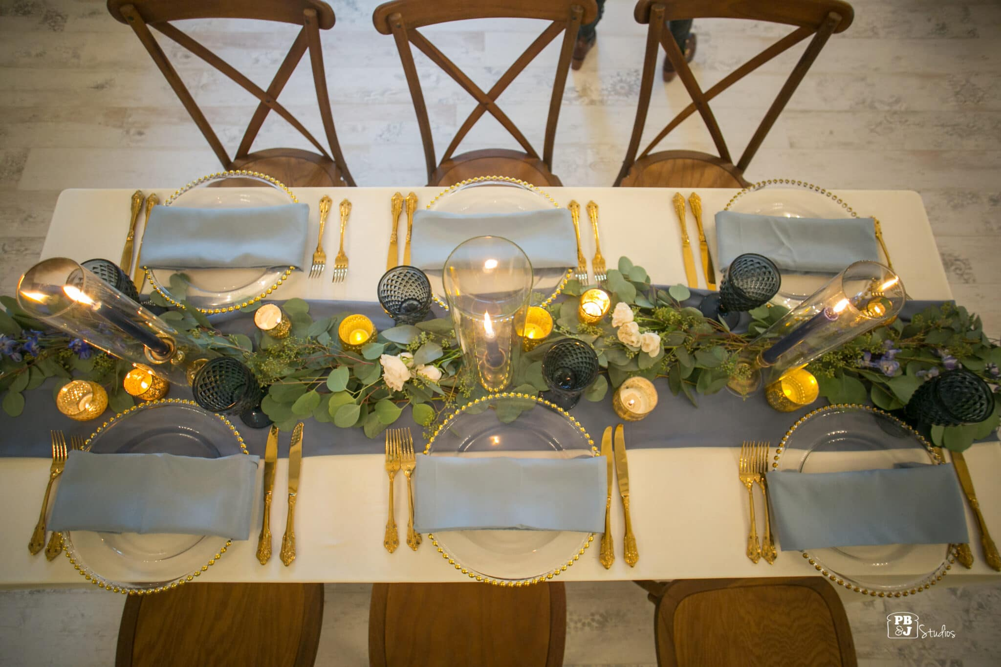 overhead view of table set with flowers & candles