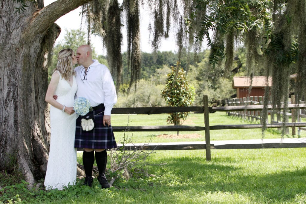 bride and groom kissing on their wedding day on an old florida farm
