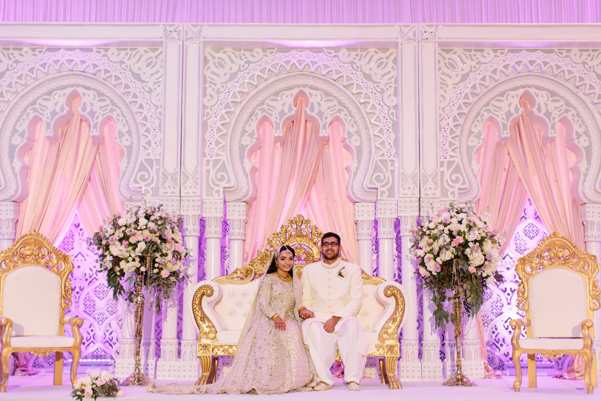bride and groom with decorative background