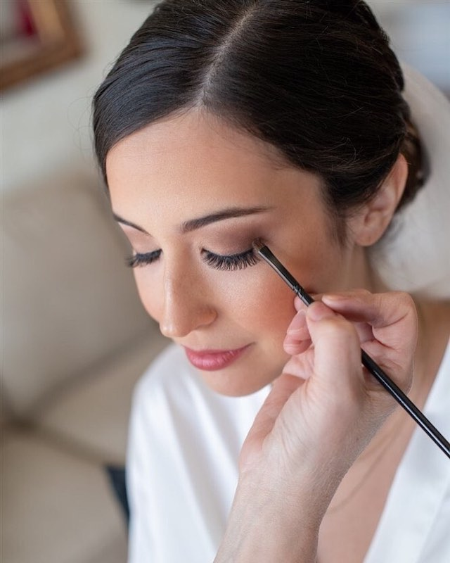 About Face Design Team applying makeup to bride