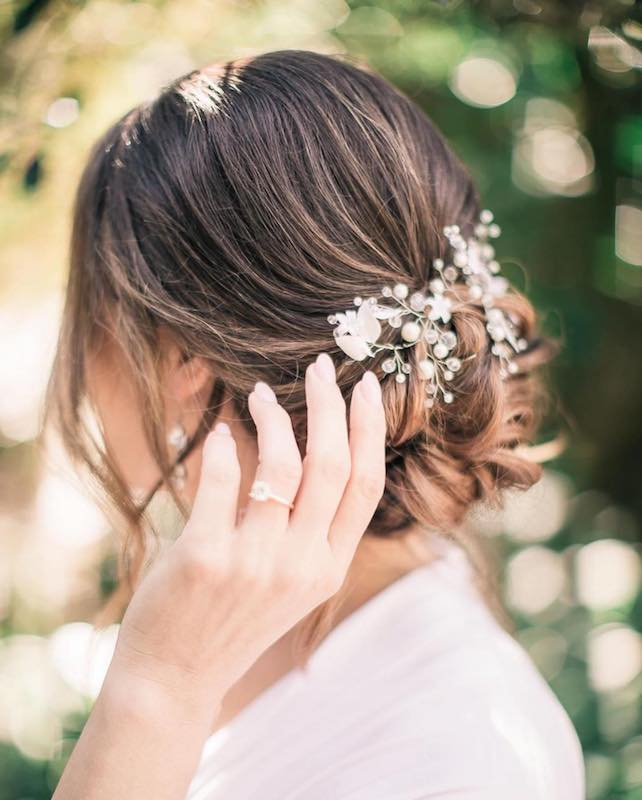 flowers and pearls used as decoration in brides hair