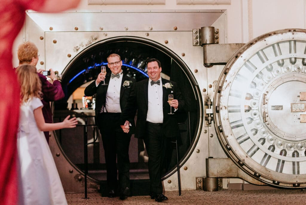 grooms exiting vault to make entrance to their wedding reception at the treasury on the plaza