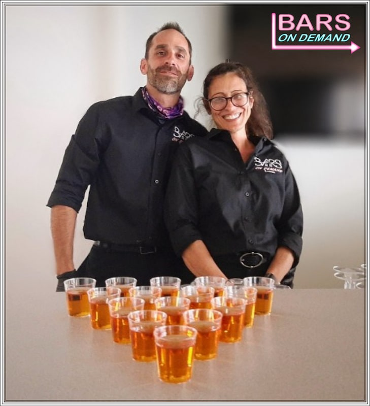 Bars on Demand, shots and drinks lined up in a triangle for guests in front of bartenders