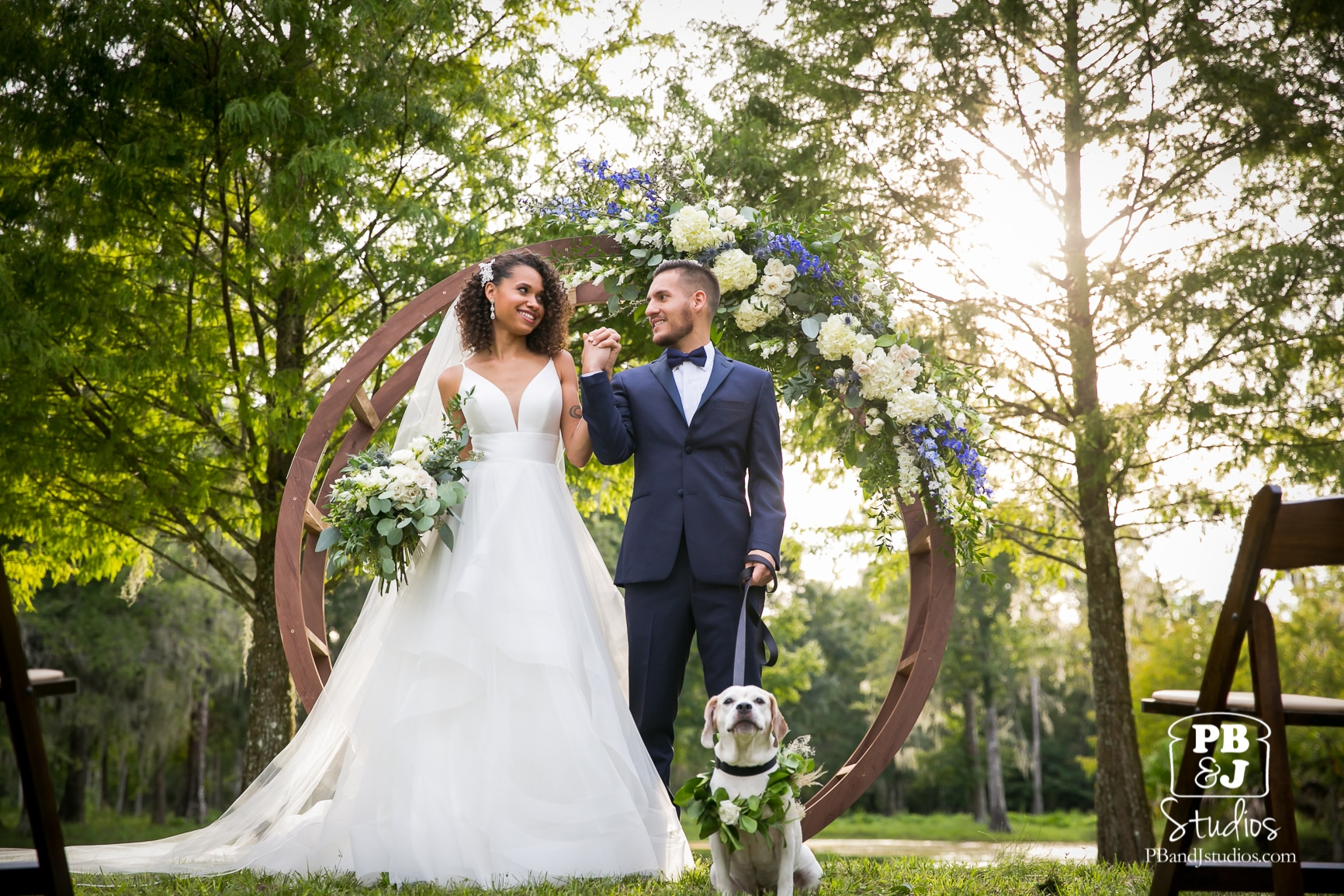 bride & groom with dog at ceremony