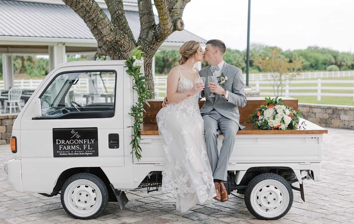 Dragonfly Farms wedding cart with couple kissing