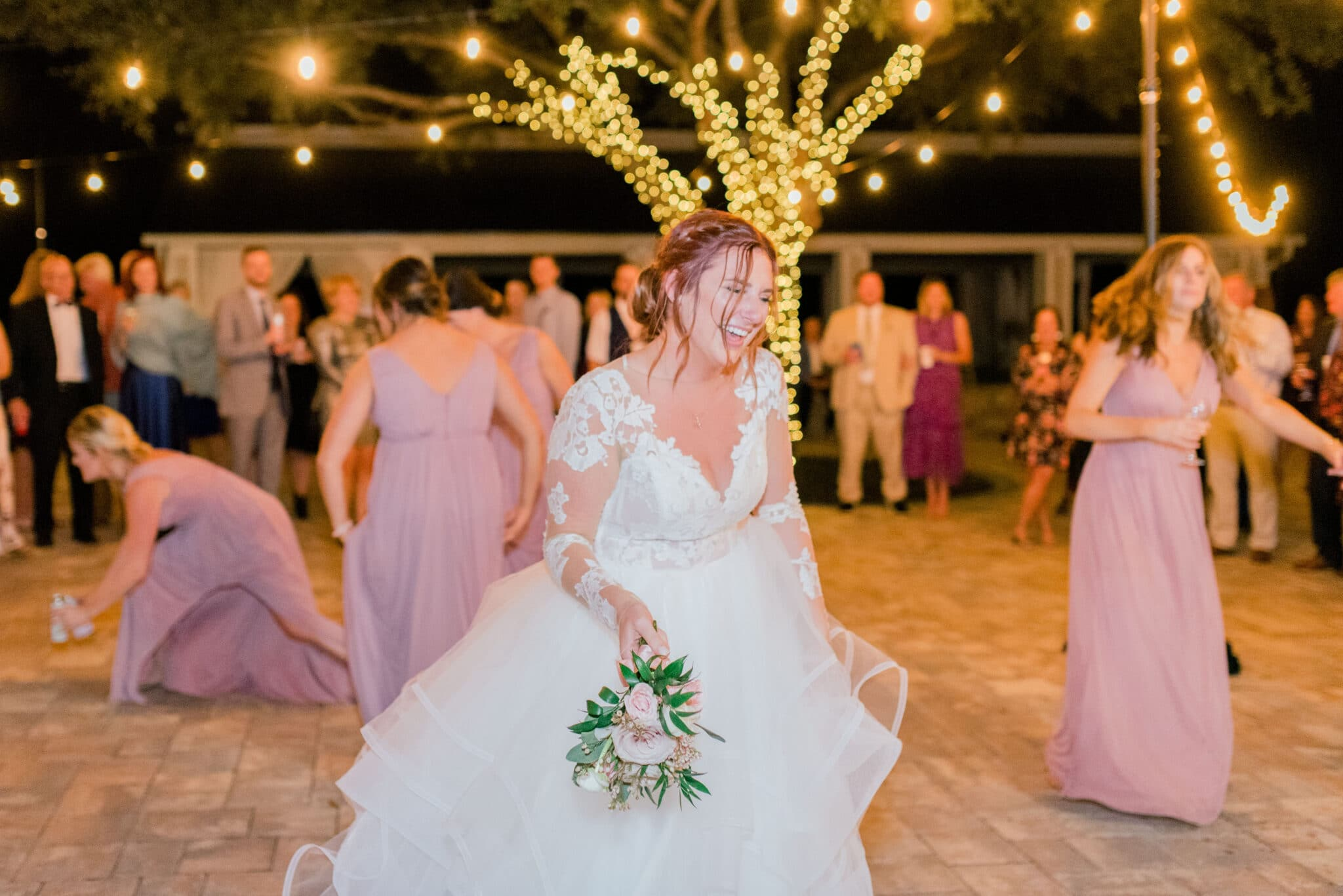 bride about to throw bouquet outside