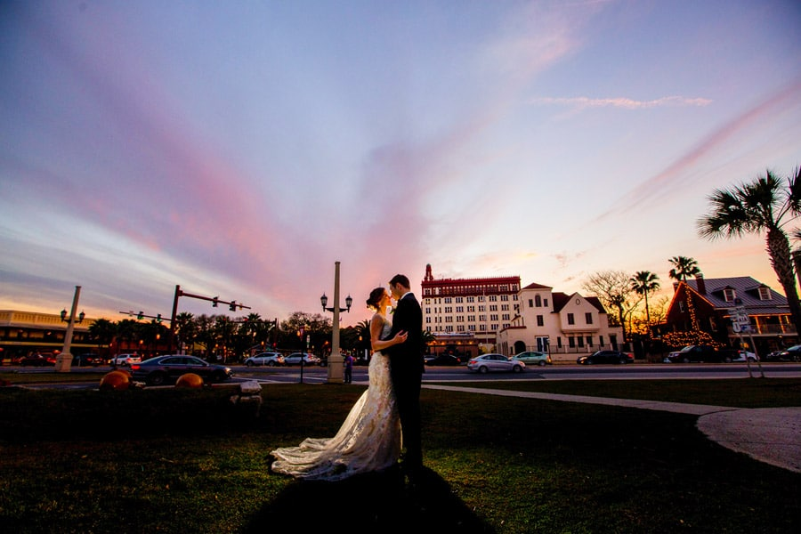 bride and groom dancing on the lawn outside of the treasury on the plaza at sunset