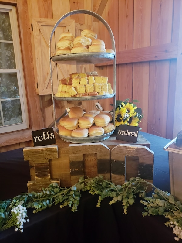 tower on buffet line filled with rolls and cornbread