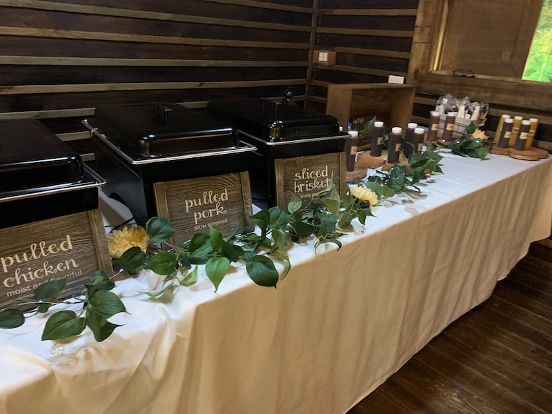 wedding buffet from Mission BBQ with meats on the left and multiple types of sauces on the right