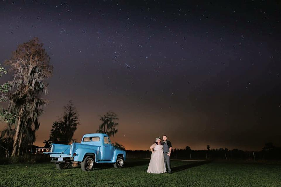 couple with pickup under starry sky