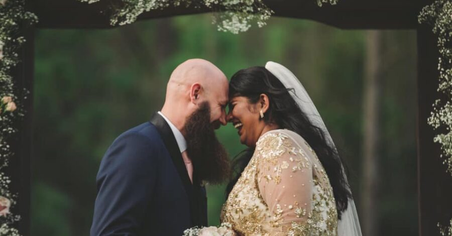 bride and groom laughing after getting married at Mystical Winds Gathering Place