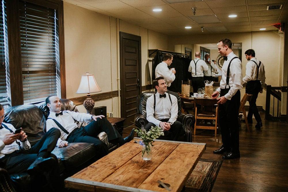 groomsmen getting ready for their friends wedding