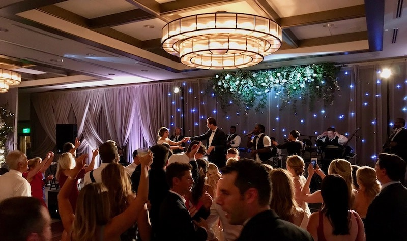 Paradigm Party band performing at large wedding reception with dance floor full