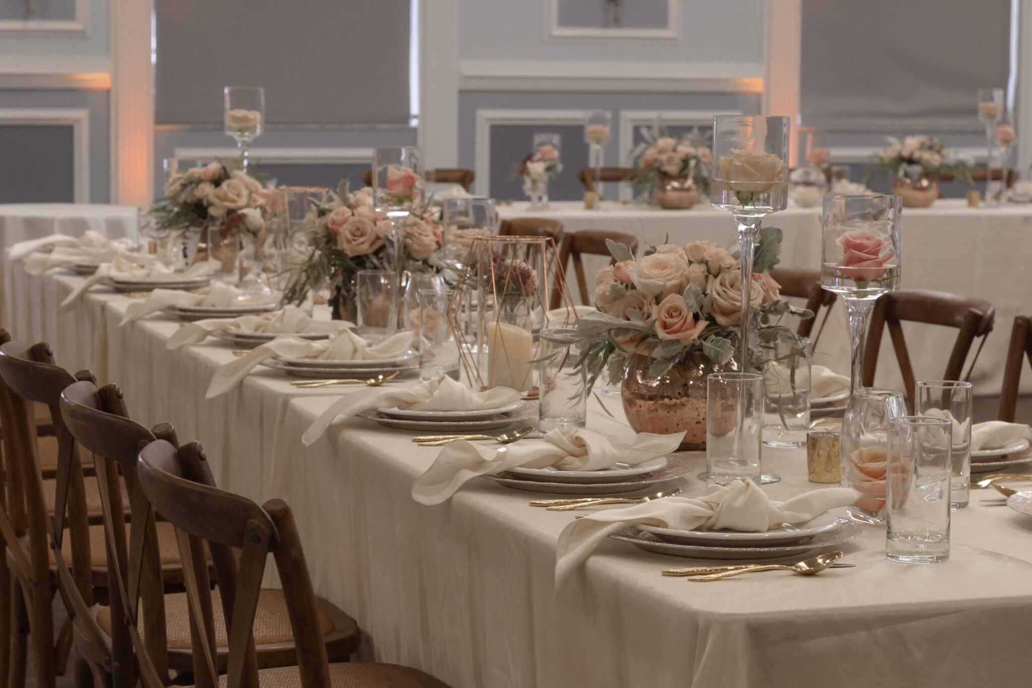 The BEV Event Center table setting, white with pink flowers